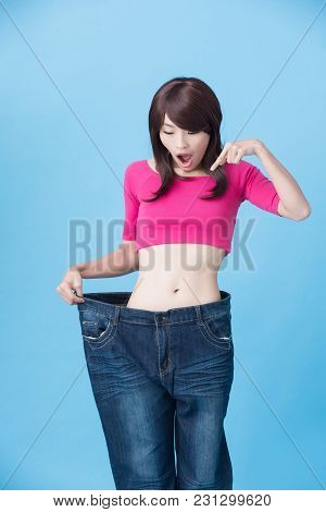 Woman Introduction Somewhere And Show Weight Loss On The Blue Background