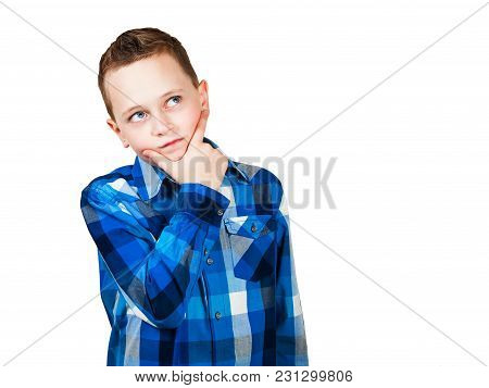 Portrait Of Thinking Boy With Hand At Face, Looking Up. Isolated On White.
