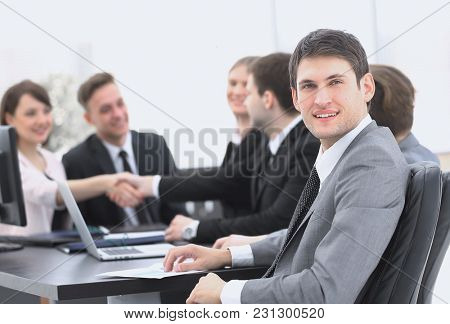 lawyer on the background of business partners handshaking