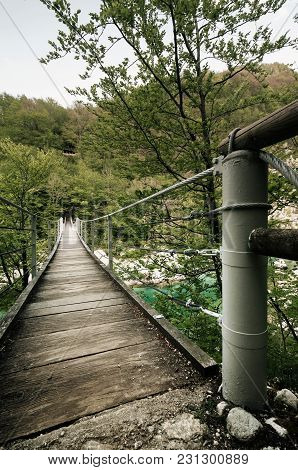 Suspension Bridge Over Emerald Slovenian River Soca