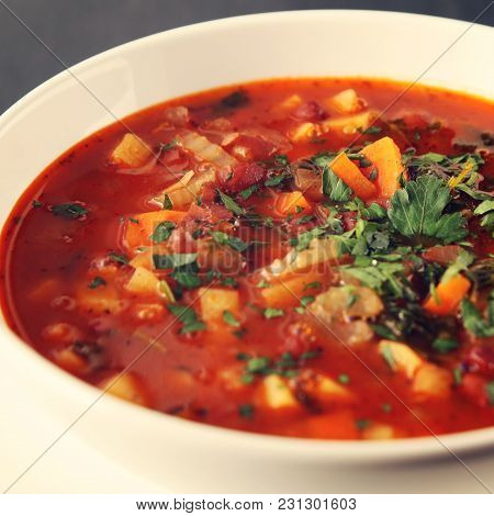 Tomato Soup With Red Beans, Potato And Carrot. Vegan. European Cuisine. Side View. Vegetarian Dish.
