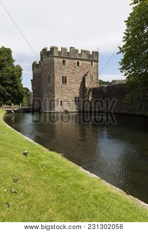 Drawbridge And Moat At The Bishops Palace In The Small City Of Wells, Somerset, Uk