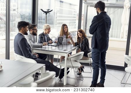 Business Team On A Morning Briefing; Business Meeting And Presentation In A Modern Office. Focus On