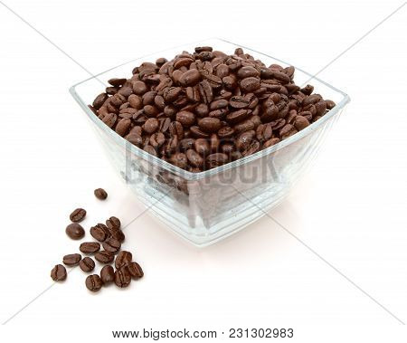 Glass Dish Filled With Coffee Beans, Some Spilled Beside