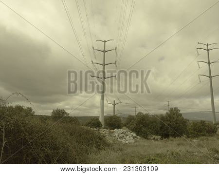 High Voltage Towers On A Stormy Day