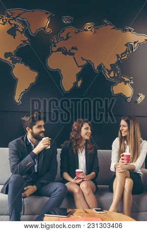 Business People Discussing Work Related Matters On A Coffee Break. Focus On The Women