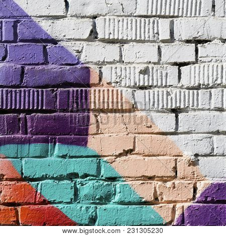Abstract Detail Of Brick Wall With Fragment Of Colorful Graffiti. Urban Art Closeup. With Place For