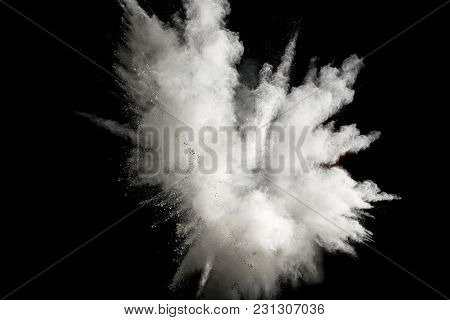 White Powder Explosion On Black Background.stopping The Movement Of White Powder On Dark Background.