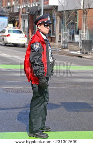 OTTAWA, CANADA - MAR. 10, 2012:  Ottawa police on duty in Saint Patrick's Day Parade in Ottawa, Canada.