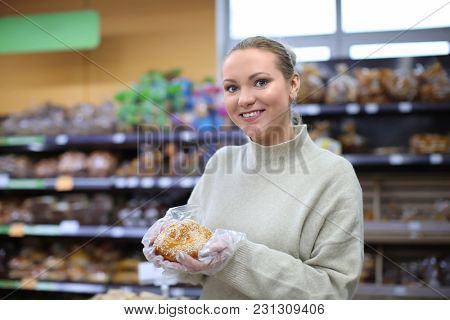 Portrait of young woman with bun in shop. Small business owner