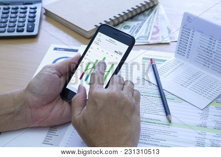 Analysing saving deposit bank account in cash flow statement management with mobile application. poster