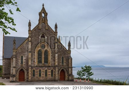 Gairloch, Scotland - June 10, 2012: The Free Church Of Scotland Brown Stone Building On The Shore Of