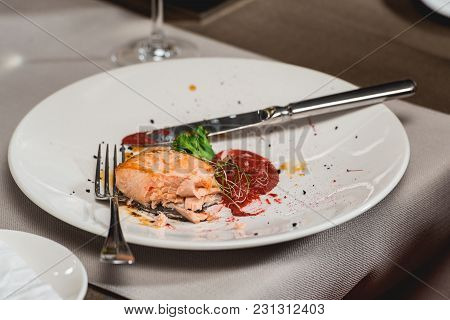 Started Portion Of Delicious Salmon In A Restaurant. Small Portion On A White Plate. Food And Wine T
