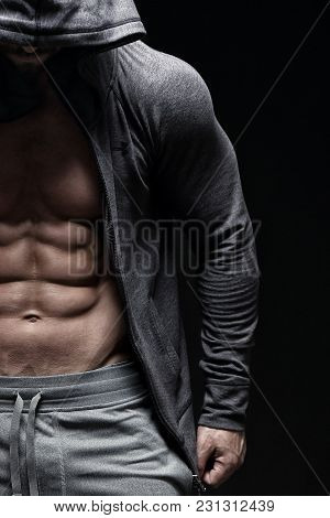 Tough Muscular Guy In Front Of Black Background