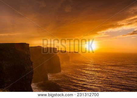 Famous Cliffs Of Moher At Sunset In Co. Clare Ireland Europe. Beautiful Landscape Natural Attraction