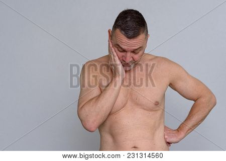 Portrait Of Naked Mature Man Looking Fed Up