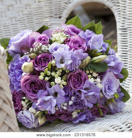 Wedding Bouquet Of Fresia On The Chair