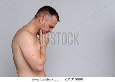 Thoughtful Shirtless Middle-aged Man