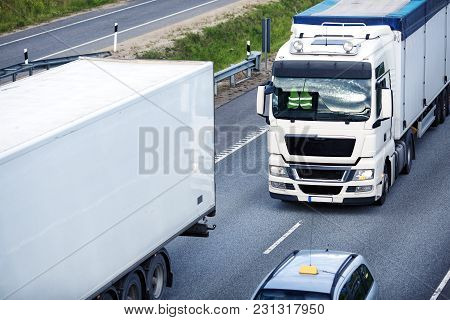 Asphalt Road With A Truck. Lorry Moving