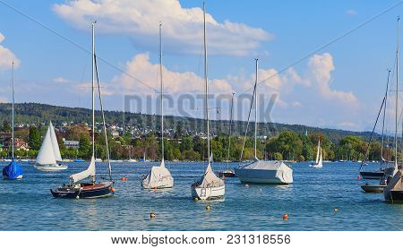 Zurich, Switzerland - 24 April, 2014: Boats On Lake Zurich, View From The City Of Zurich. Lake Zuric