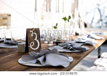 Wedding Table Decoration. Wedding Tablets On The Table. Table Number Three. Wedding Textiles On The