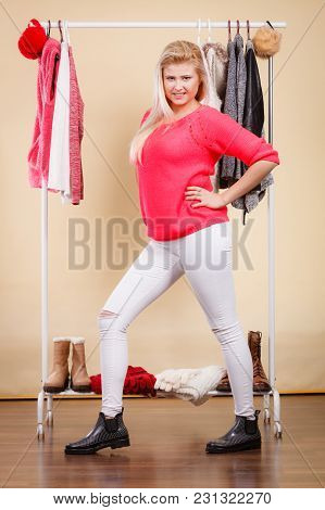 Fashionable Style, Trendy Clothes, Thinking About Clothing Concept. Blonde Woman Standing In Wardrob