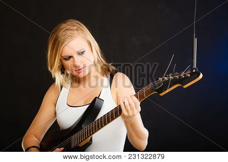 Music, Singing Concept. Musically Talented Woman Playing On Electric Guitar And Singing In Studio, B