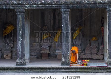 Siem Reap , Cambodia - Oct 17 : Budhist Monk At The Angkor Wat Temple In Siem Reap Cambodia On Octob