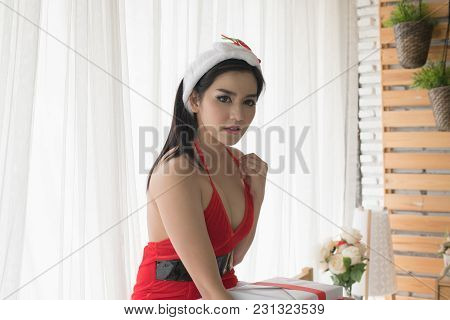New Year Concept. Beautiful Happy Woman In Sexy Santa Claus Clothes. Beautiful Girl In Santa Claus C