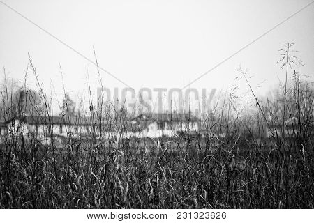 Field With Houses On The Background, Hdr Black And White Image, Horizontal Image