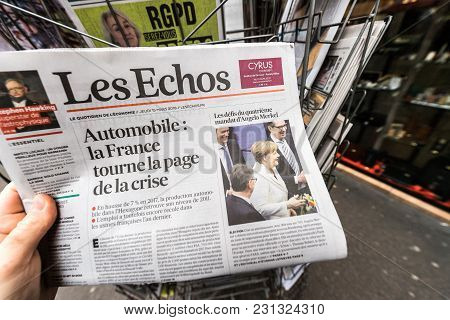 Paris, France - Mar 15, 2017: Man Reading Buying French Les Echos Newspaper At Press Kiosk Featuring