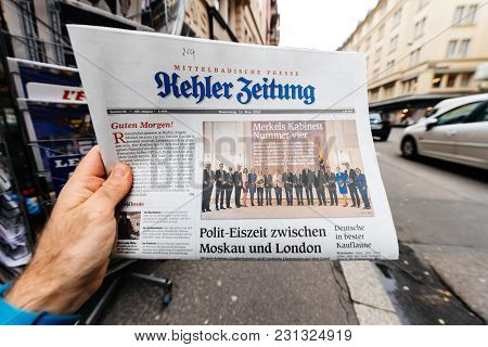 Paris, France - Mar 15, 2017: Man Reading Buying German Kehler Zeitung Newspaper At Press Kiosk Feat