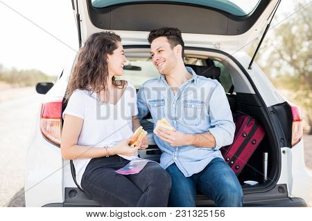 Romantic Couple On Road Trip Having Sandwiches