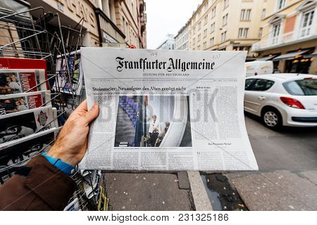 Paris, France - Mar 15, 2017: Man Reading Buying German Frankfurter Allgemeine Zeitung Newspaper At
