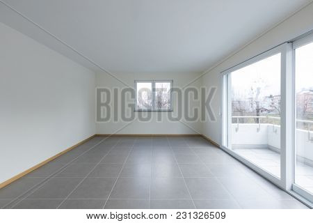 Empty room with large window on the balcony
