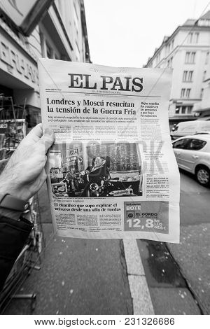 Paris, France - Mar 15, 2018: Male Hand Holding Spanish El Pais Newspaper With Portrait Of Stephen H