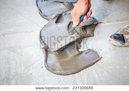 Process Of Laying Floor Ceramic Tiles, Application Of The Adhesive Base