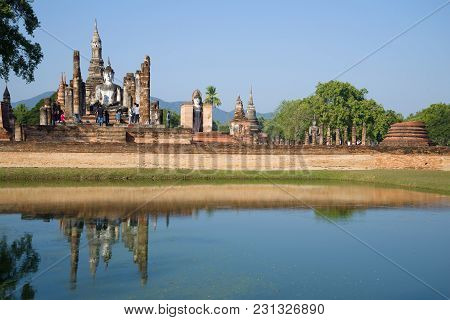 A Sunny Morning On The Ruins Of The Buddhist Temple Of Wat Mahathat. Sukhothai Park, Thailand