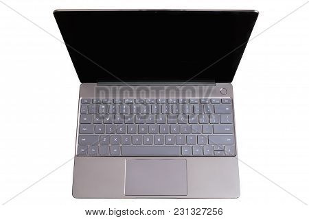 Opened Modern Gray Laptop With Us Keypad, Touchpad And Empty Blank Screen Isolated On White Backgrou