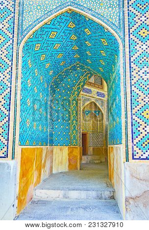 The Narrow Arched Corridor Of Chaharbagh Madraseh Is Deorated With Nice Geometric Mosaic Patterns In