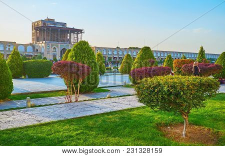 Isfahan, Iran - October 20, 2017: The Medieval Qapu Palace In Naqsh-e Jahan Square Is Seen Through T