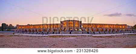 Isfahan, Iran - October 20, 2017: The  Evening Panorama Of Khaju Bridge From The Dried Up Bottom Of