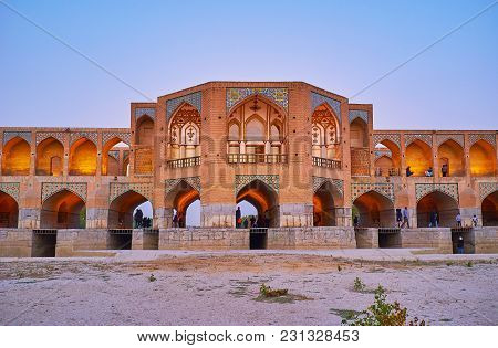 Isfahan, Iran - October 20, 2017: The Arched Portal Of Brick Khaju Bridge With Niches, Decorated Wit