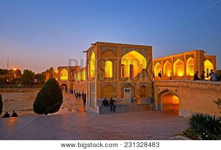 Isfahan, Iran - October 20, 2017: The Parks Along The Zayandeh River And Medieval Bridges Across It