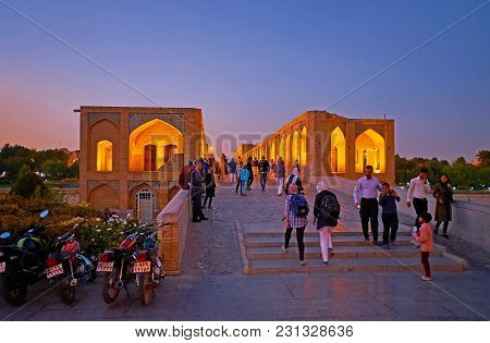 Isfahan, Iran - October 20, 2017: The Evening Walk Along The Crowded Khaju Bridge - One Of The Centr