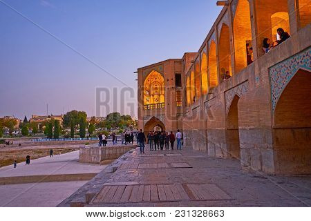 Isfahan, Iran - October 20, 2017: The  Khaju Bridge Is Popular Meeting Place Among The Locals And Fa