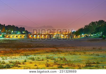 The Pleasant Evening Walk In Moshtagh-e Aval Park With A View On Dried Up Zayandeh River And  Arched