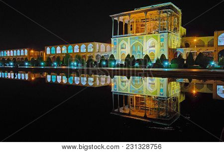 The Evening Walk Around The Fountains In Nagsh-e Jahan Square, Famous For Its Architectural Ensemble