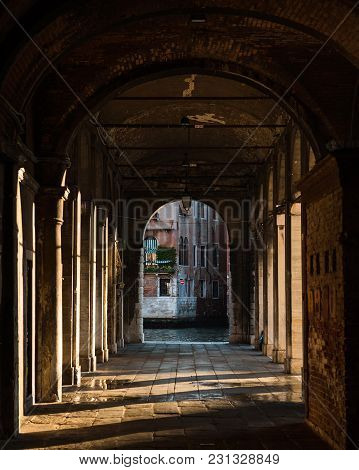 Sunrise Rays Coming Through The Arches And Columns In Venice, Italy