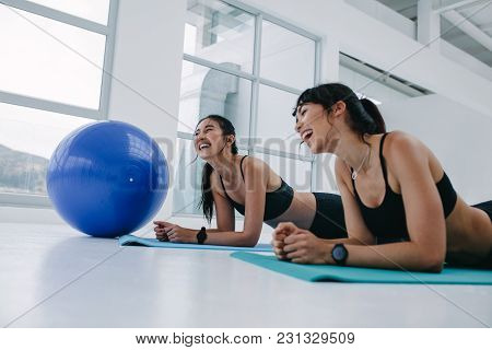 Friends Enjoying During Training Session At Gym